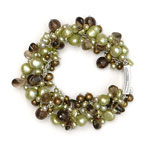 Light and dark green pearls, olivine crystals, smokey quartz pebbles and faceted beads[381]